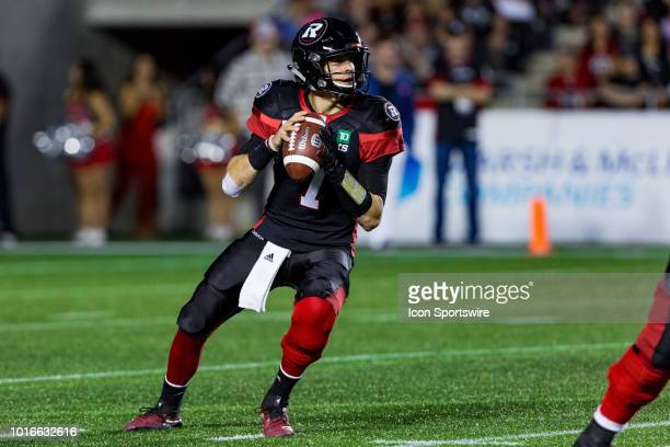 Ottawa Redblacks quarterback Trevor Harris looks to make a pass during Canadian Football League action between the Montreal Alouettes and Ottawa...