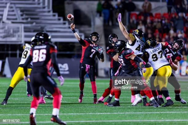 Ottawa RedBlacks quarterback Trevor Harris pass the football during Canadian Football League action between Hamilton TigerCats and Ottawa RedBlacks...