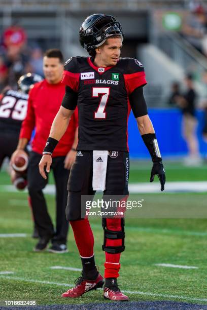 Ottawa Redblacks quarterback Trevor Harris walks on the field during warmup before Canadian Football League action between the Montreal Alouettes and...
