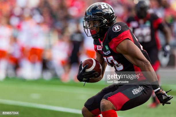 Ottawa RedBlacks running back Mossis Madu Jr runs looking for space during Canadian Football League action between BC Lions and Ottawa RedBlacks on...