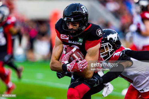 Ottawa RedBlacks wide receiver Brad Sinopoli runs with the football as he attempts to break a tackle during Canadian Football League action between...