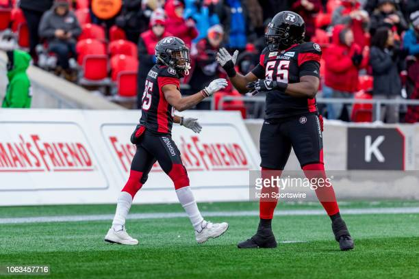 Ottawa Redblacks wide receiver Diontae Spencer celebrates his touchdown with Ottawa Redblacks offensive lineman SirVincent Rogers during Canadian...