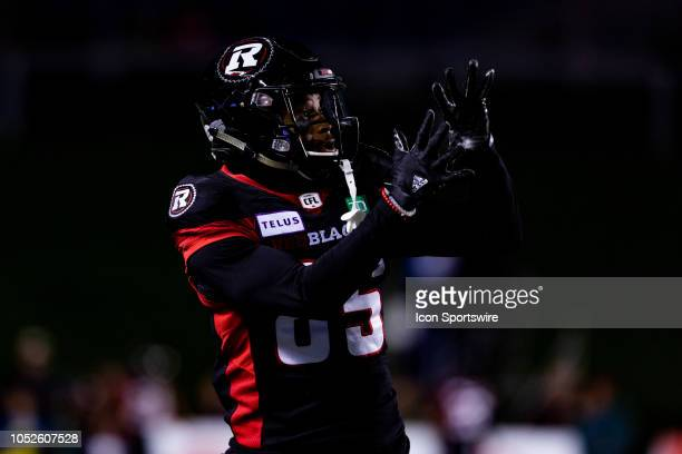 Ottawa Redblacks wide receiver Diontae Spencer prepares to catch a pass in warmup before Canadian Football League action between the Hamilton...