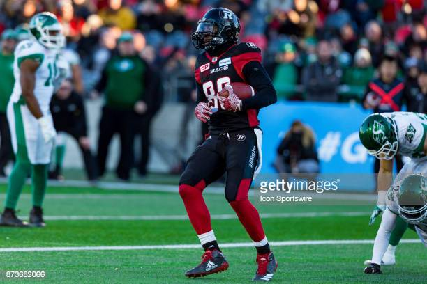 Ottawa RedBlacks wide receiver Juron Criner hangs onto the football after scoring a touchdown during Canadian Football League Eastern SemiFinal...