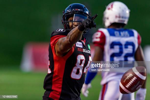 Ottawa Redblacks wide receiver RJ Harris points for a first down after a successful catch during Canadian Football League action between the Montreal...
