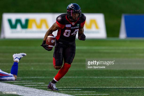 Ottawa Redblacks wide receiver RJ Harris runs down the sideline after breaking a tackle during Canadian Football League action between the Montreal...