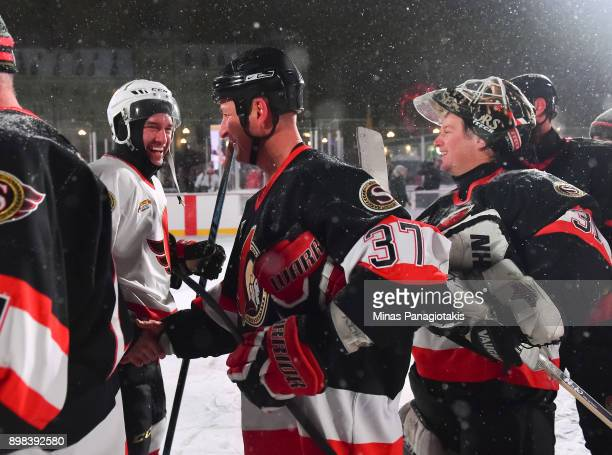 Ottawa Senators alumni Brad Smyth shakes hands with Alexandre Daigle during the 2017 Scotiabank NHL100 Classic Ottawa Senators Alumni Game on...