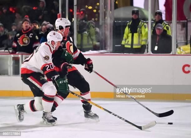 Ottawa Senators alumni Chris Neil pulls the puck away from Magnus Arvedson during the 2017 Scotiabank NHL100 Classic Ottawa Senators Alumni Game on...