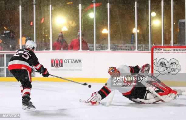 Ottawa Senators alumni Chris Neil skates in for a penalty shot on Patrick Lalime during the 2017 Scotiabank NHL100 Classic Ottawa Senators Alumni...