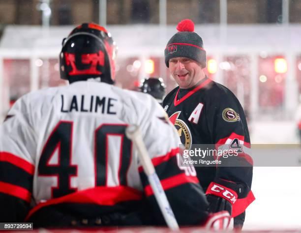 Ottawa Senators alumni Chris Phillips talks with Patrick Lalime during the 2017 Scotiabank NHL100 Classic Ottawa Senators Alumni Game on Parliament...