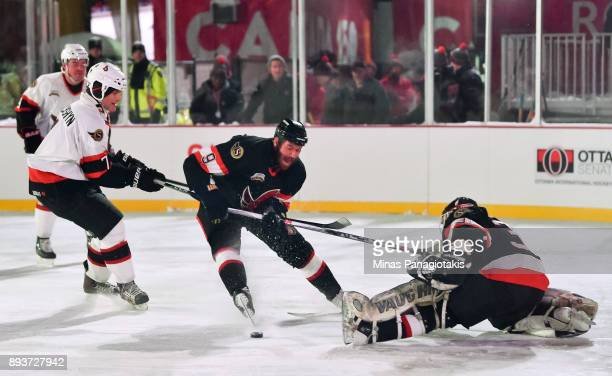 Ottawa Senators alumni Curtis Leschyshyn battles for a loose puck with Martin Havlat in front of Ron Tugnutt during the 2017 Scotiabank NHL100...