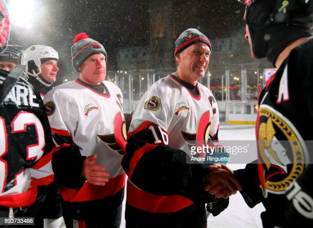 Ottawa Senators alumni Daniel Alfredsson and Laurie Boschman shake hands with Team Phillips during the 2017 Scotiabank NHL100 Classic Ottawa Senators...