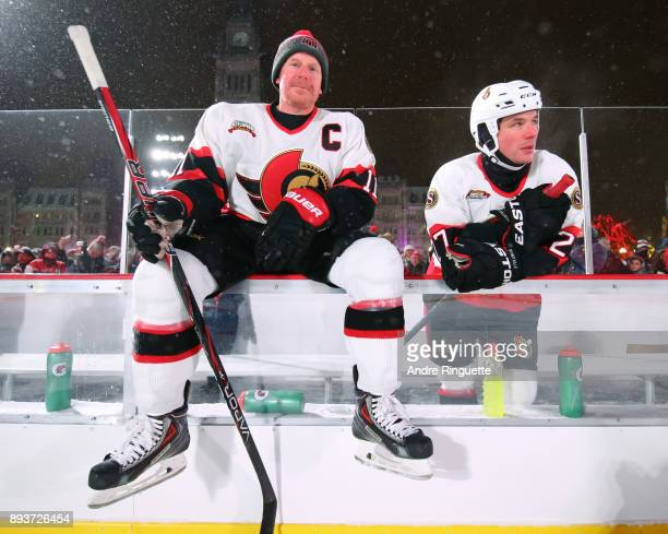 Ottawa Senators alumni Daniel Alfredsson and Randy Robitaille sit on the bench between shifts during the 2017 Scotiabank NHL100 Classic Ottawa...