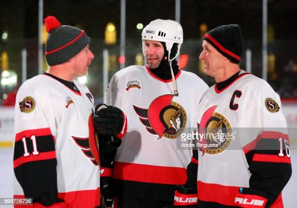 Ottawa Senators alumni Daniel Alfredsson Radek Bonk and Laurie Boschman catch up during the 2017 Scotiabank NHL100 Classic Ottawa Senators Alumni...