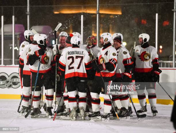Ottawa Senators alumni from Team Alfredsson celebrate at the end of the game during the 2017 Scotiabank NHL100 Classic Ottawa Senators Alumni Game on...