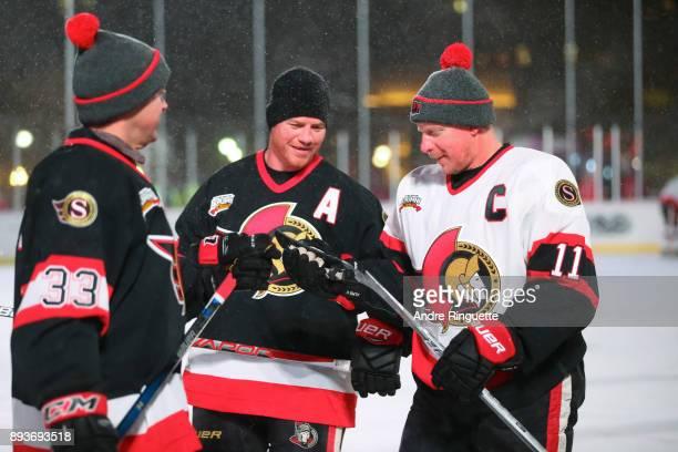 Ottawa Senators alumni Jason York Chris Neil and Daniel Alfredsson warm up before the 2017 Scotiabank NHL100 Classic Ottawa Senators Alumni Game on...