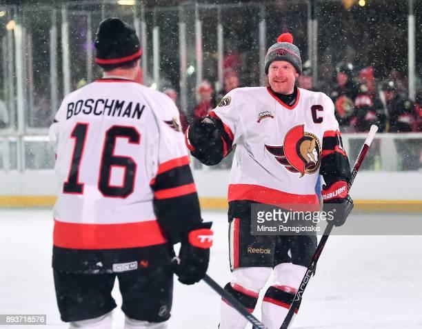 Ottawa Senators alumni Laurie Boschman celebrates with Daniel Alfredsson after scoring a first period goal during the 2017 Scotiabank NHL100 Classic...