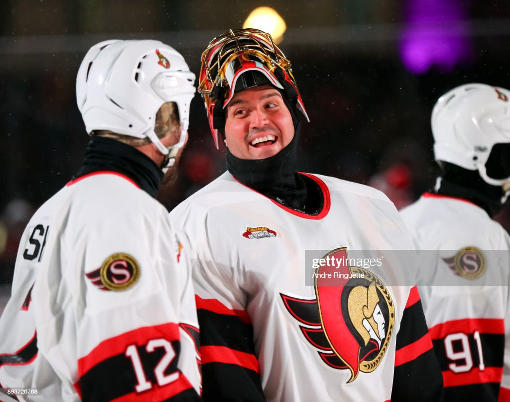 Ottawa Senators alumni Mike Fisher #12 and Patrick Lalime #40 talk during the 2017 Scotiabank NHL100 Classic Ottawa Senators Alumni Game on Parliament Hill on December 15, 2017 in Ottawa, Canada.