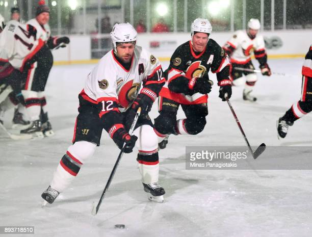 Ottawa Senators alumni Mike Fisher stickhandles the puck with Chris Neil chasing during the 2017 Scotiabank NHL100 Classic Ottawa Senators Alumni...