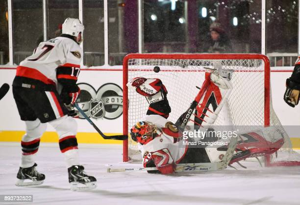Ottawa Senators alumni Patrick Lalime dives for the puck during the 2017 Scotiabank NHL100 Classic Ottawa Senators Alumni Game on Parliament Hill on...