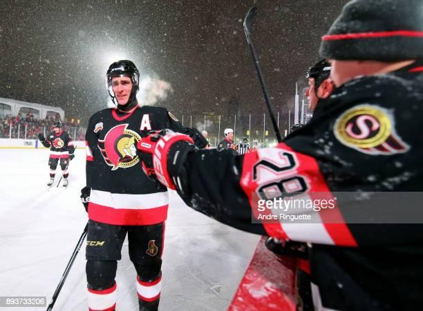 Ottawa Senators alumni Wade Redden high fives the bench during the 2017 Scotiabank NHL100 Classic Ottawa Senators Alumni Game on Parliament Hill on...