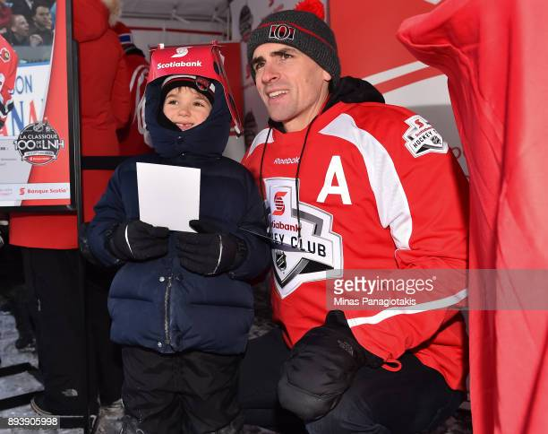Ottawa Senators alumni Wade Redden poses for a photo with a young fan during the 2017 Scotiabank NHL100 Classic at Lansdowne Park on December 16 2017...