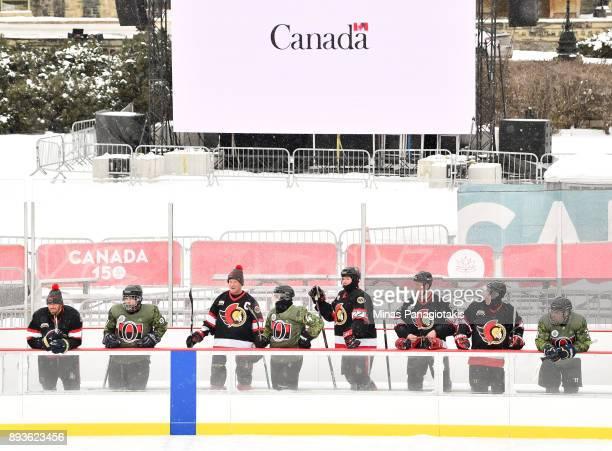 Ottawa Senators alumni watch from the bench during the 2017 Scotiabank NHL100 Classic Ottawa Senators Alumni Skate on Parliament Hill on December 15...