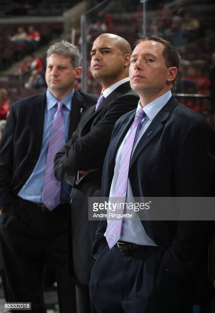 Ottawa Senators assistant coaches Curtis Hunt Eli Wilson and Greg Carvel wear their Hockey Fights Cancer ties during warmups prior to a game against...