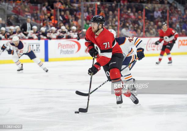 Ottawa Senators Center Chris Tierney stickhandles the puck against Edmonton Oilers Right Wing Josh Currie during the second period of the NHL game...