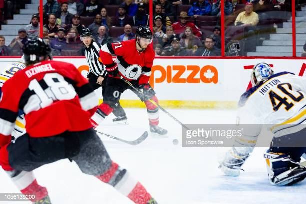 Ottawa Senators Center Chris Tierney tries to control the puck to get a shot on net during second period National Hockey League action between the...