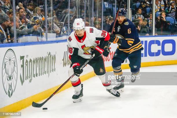 Ottawa Senators center Colin White skates with the puck as Buffalo Sabres defenseman Marco Scandella defends during the Ottawa Senators and Buffalo...