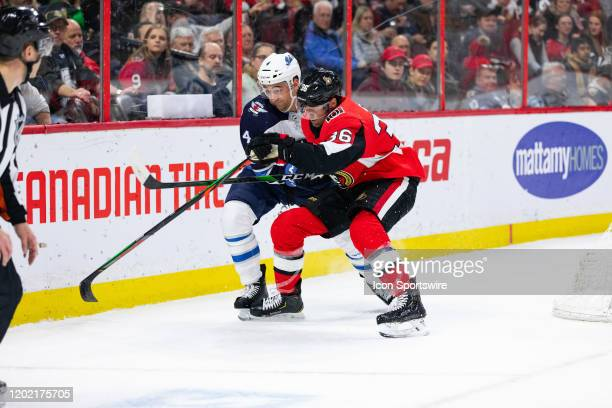 Ottawa Senators center Colin White tries to out muscle Winnipeg Jets defenseman Neal Pionk during second period National Hockey League action between...