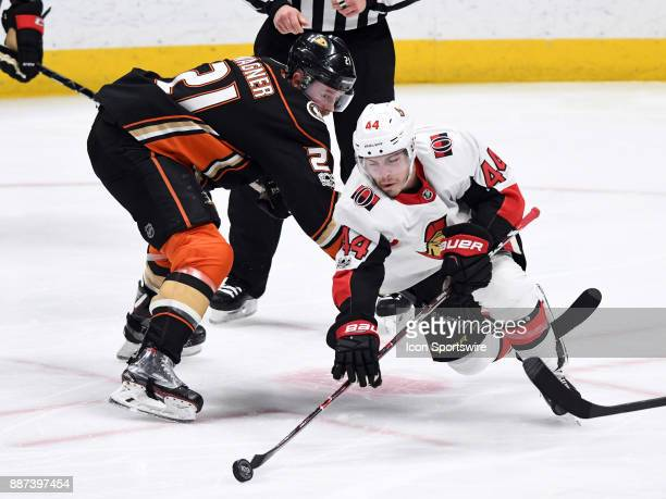 Ottawa Senators center JeanGabriel Page dives past Anaheim Ducks center Chris Wagner for the puck in the second period of a game played on December 6...