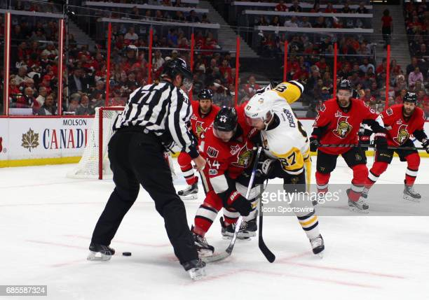 Ottawa Senators Center JeanGabriel Pageau and Pittsburgh Penguins Center Sidney Crosby face off in the third period of Game 4 of the Eastern...