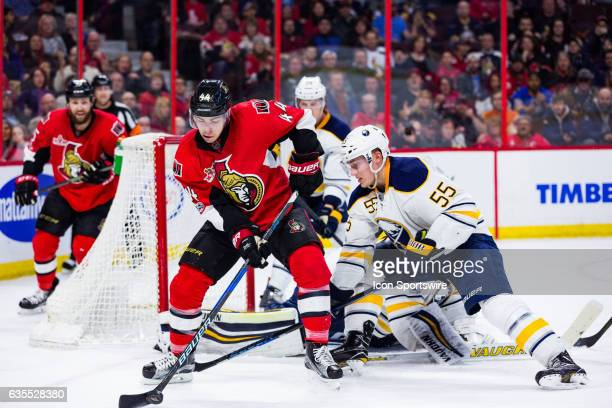 Ottawa Senators Center JeanGabriel Pageau controls the puck in front of the Buffalo net as Buffalo Sabres Defenceman Rasmus Ristolainen tries to...