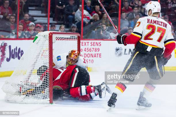 Ottawa Senators Center JeanGabriel Pageau crashes into Calgary Flames Goalie David Rittich after being tripped by Calgary Flames Defenceman Dougie...