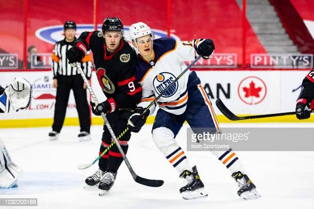 Ottawa Senators Center Josh Norris battles Edmonton Oilers Right Wing Jesse Puljujarvi during third period National Hockey League action between the...