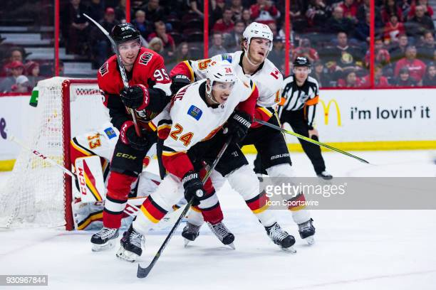 Ottawa Senators Center Matt Duchene battles Calgary Flames Defenceman Travis Hamonic and Calgary Flames Left Wing Matthew Tkachuk for position during...