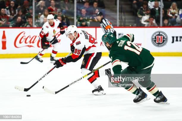Ottawa Senators center Matt Duchene skates with the puck while Minnesota Wild center Eric Staal defends during the game between the Ottawa Senators...