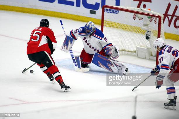 Ottawa Senators Center Zack Smith is stopped by New York Rangers Goalie Henrik Lundqvist on the break away in the first period of Game 5 of the 2nd...