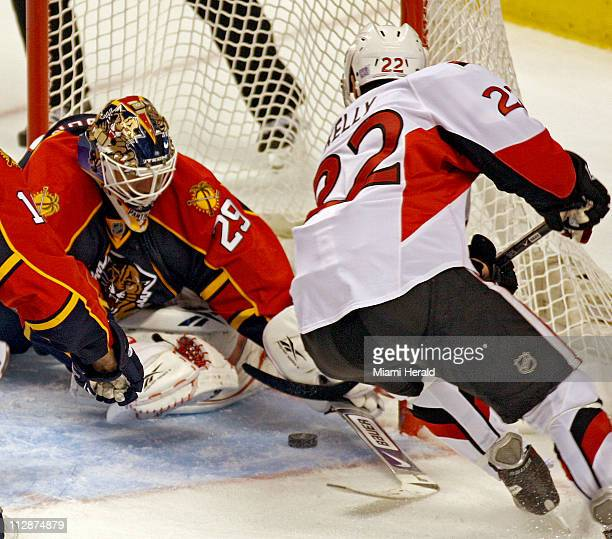 Ottawa Senators' Chris Kelly shoots the gamewinning goal against Florida Panthers goalie Tomas Vokoun during the third period at the Bank Atlantic...