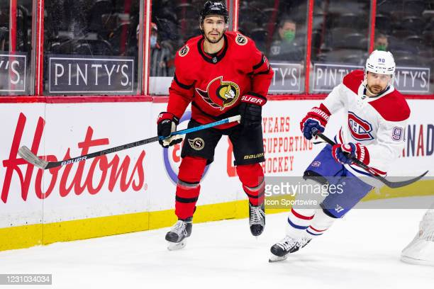 Ottawa Senators Defenceman Artem Zub keeps eyes on the play as Montreal Canadiens Left Wing Tomas Tatar skates by during second period National...