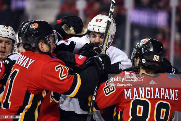 Ottawa Senators Defenceman Ben Harpur mixes it up with Calgary Flames Right Wing Garnet Hathaway and Left Wing Andrew Mangiapane after a whistle...