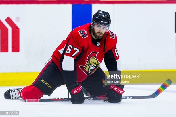 Ottawa Senators Defenceman Ben Harpur stretches rainbow tape can be seen on his stick showing support for Hockey is for Everyone during warmup before...