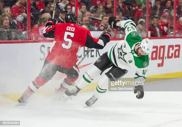 Ottawa Senators Defenceman Cody Ceci and Dallas Stars Right Wing Alexander Radulov clash against the boards during the third period of the NHL game...