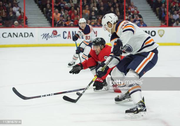 Ottawa Senators Defenceman Cody Ceci and Edmonton Oilers Right Wing Alex Chiasson battle for the puck during the third period of the NHL game between...