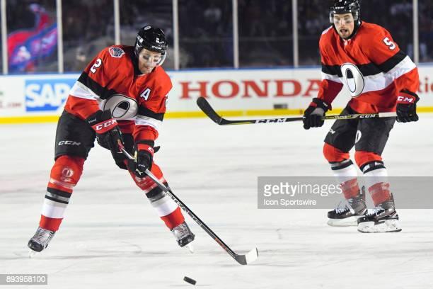 Ottawa Senators Defenceman Dion Phaneuf shoots the puck during the Montreal Canadiens versus the Ottawa Senators NHL100 Classic game on December 16...