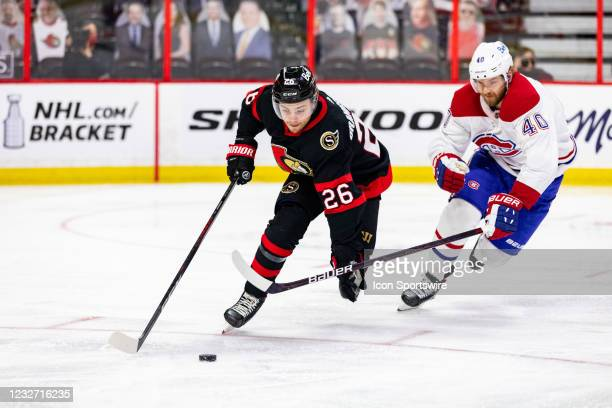 Ottawa Senators Defenceman Erik Brannstrom defends the puck from Montreal Canadiens Right Wing Joel Armia during second period National Hockey League...
