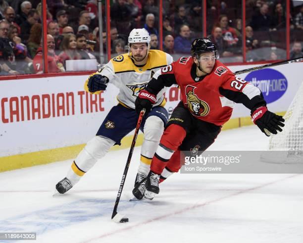 Ottawa Senators Defenceman Erik Brannstrom stickhandles the puck against Nashville Predators Left Wing Filip Forsberg during the third period of the...