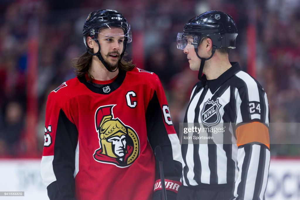 Ottawa Senators Defenceman Erik Karlsson (65) talks to Referee Graham Skilliter (24) during third period National Hockey League action between the Winnipeg Jets and Ottawa Senators on April 2, 2018, at Canadian Tire Centre in Ottawa, ON, Canada.